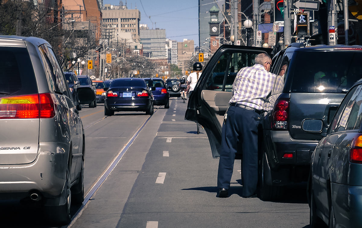 Anticipate cars opening their doors when cycling