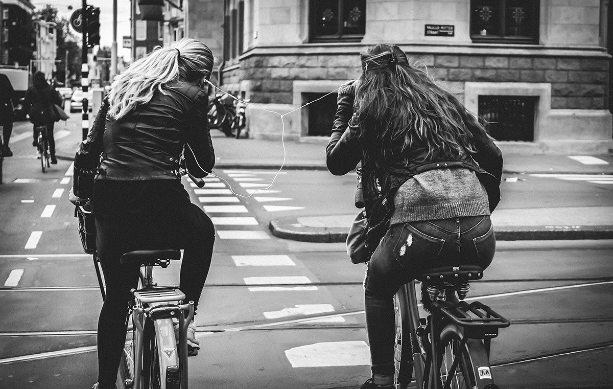 In both ears   Bicycle Street Photography Amsterdam