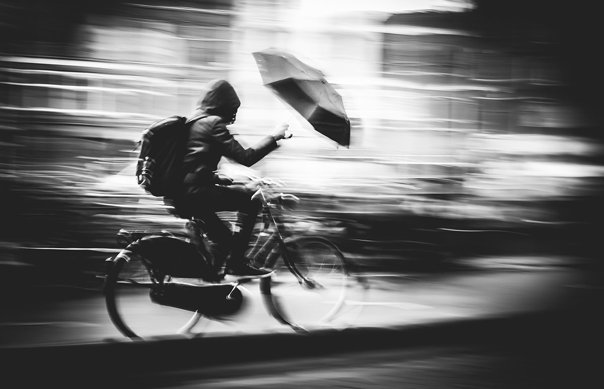 Storm Chaser | Bicycle Street Photography Amsterdam