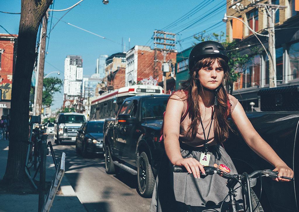 Cyclist along Queen West. Bike Toronto
