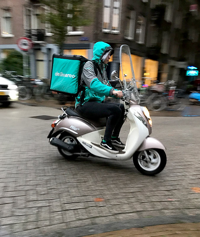 Delivering on a scooter