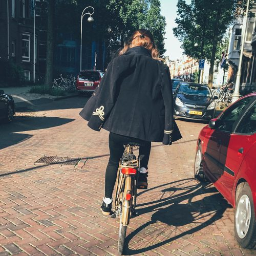 Girl riding bicycle in Amsterdam