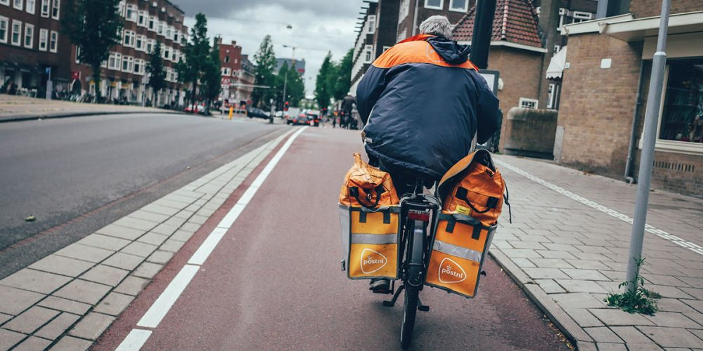 Delivering mail on bicycle