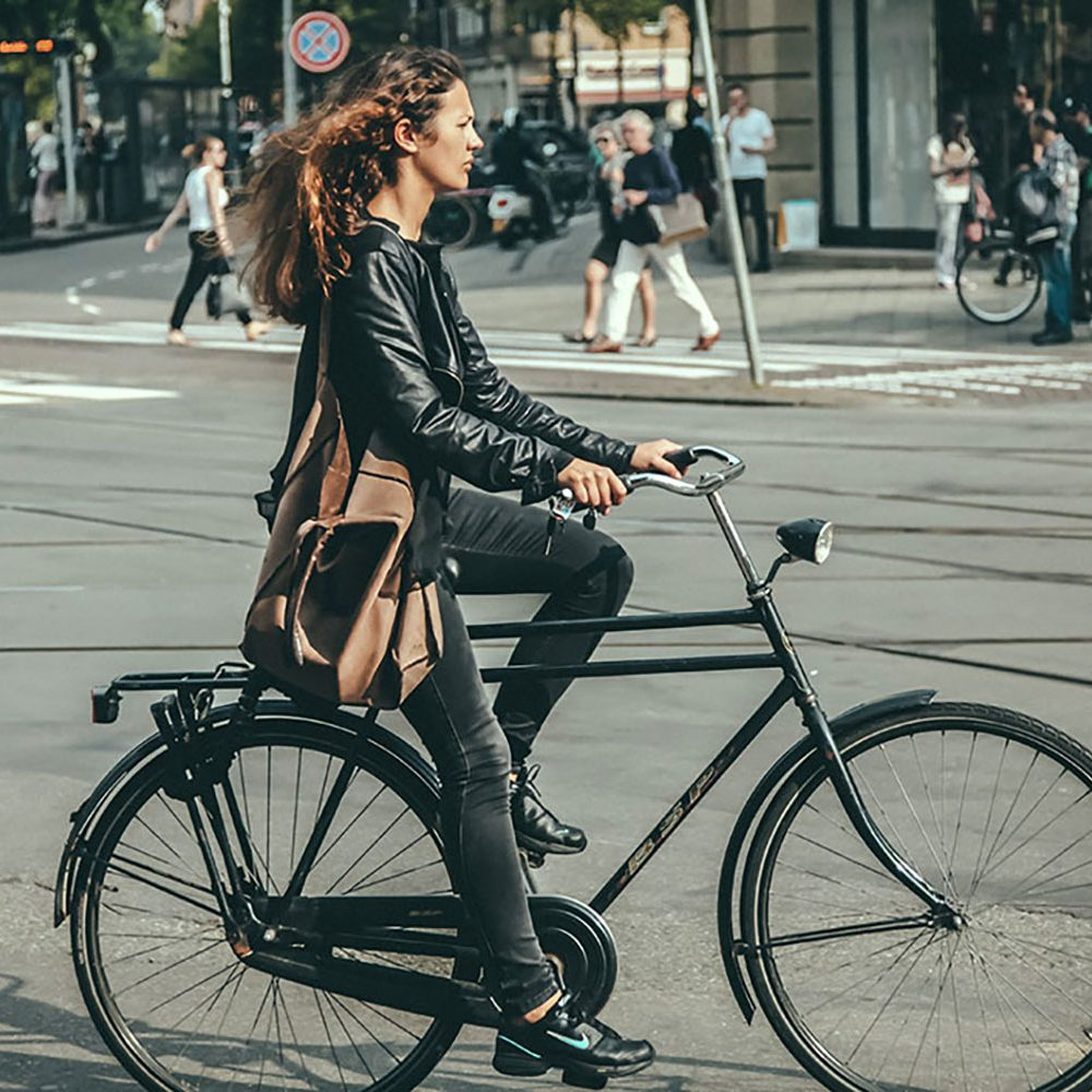 Girl riding a double top tube bicycle