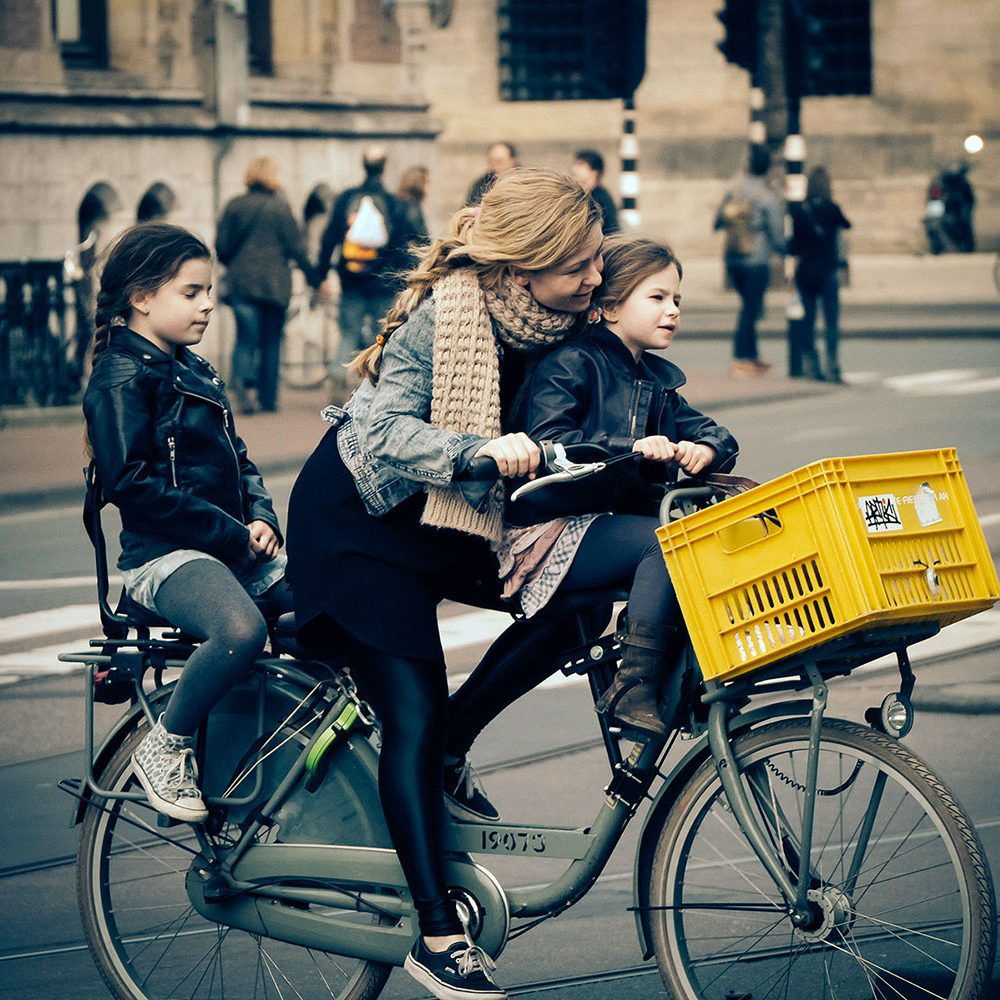 Mom with kids on a bike