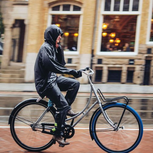 Riding a Swapfiets bicycle in the rain