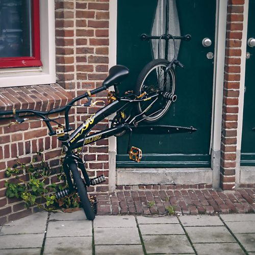 Bicycle hanging from door