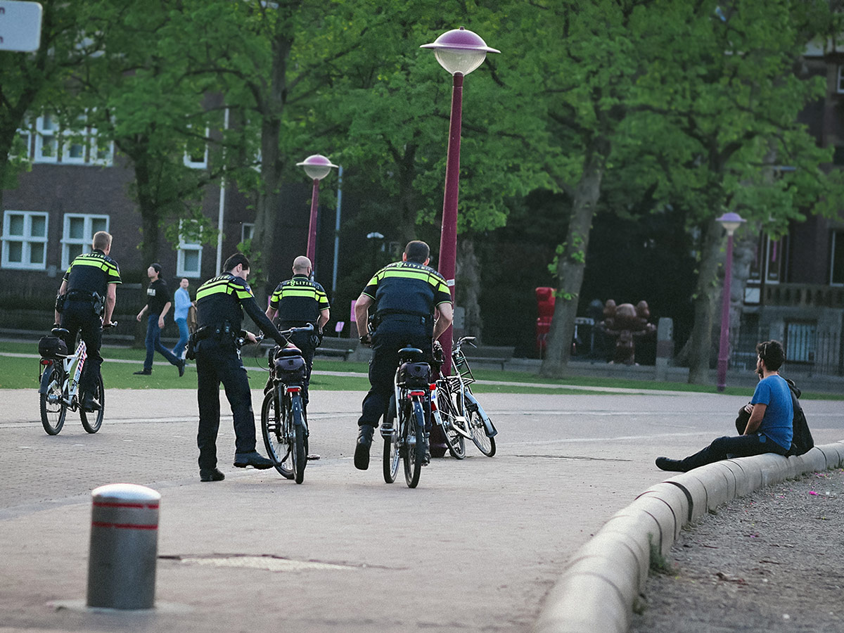 Police on bikes in Amsterdam during COVID-19 Pandemic