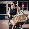 Girl cycling with wicker bike basket