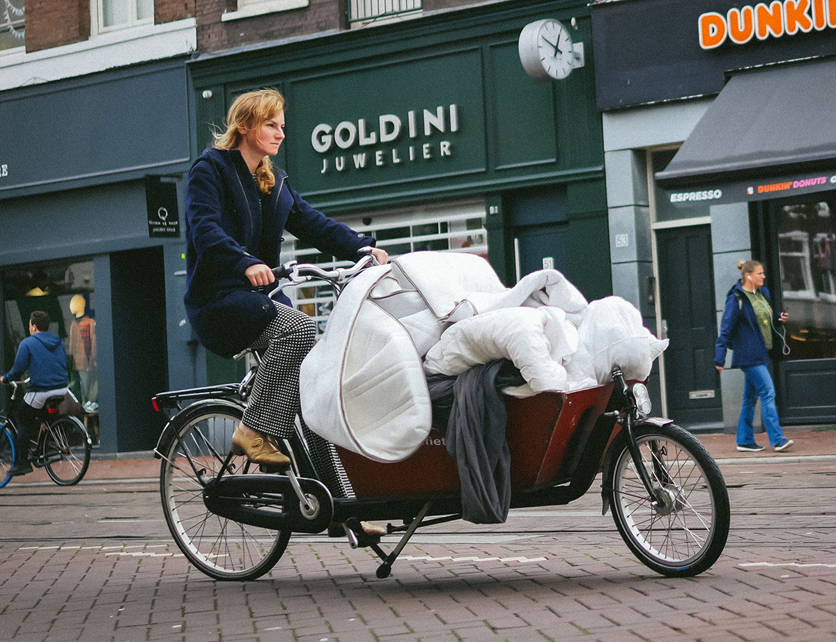 Woman Riding a loaded Bakfiets