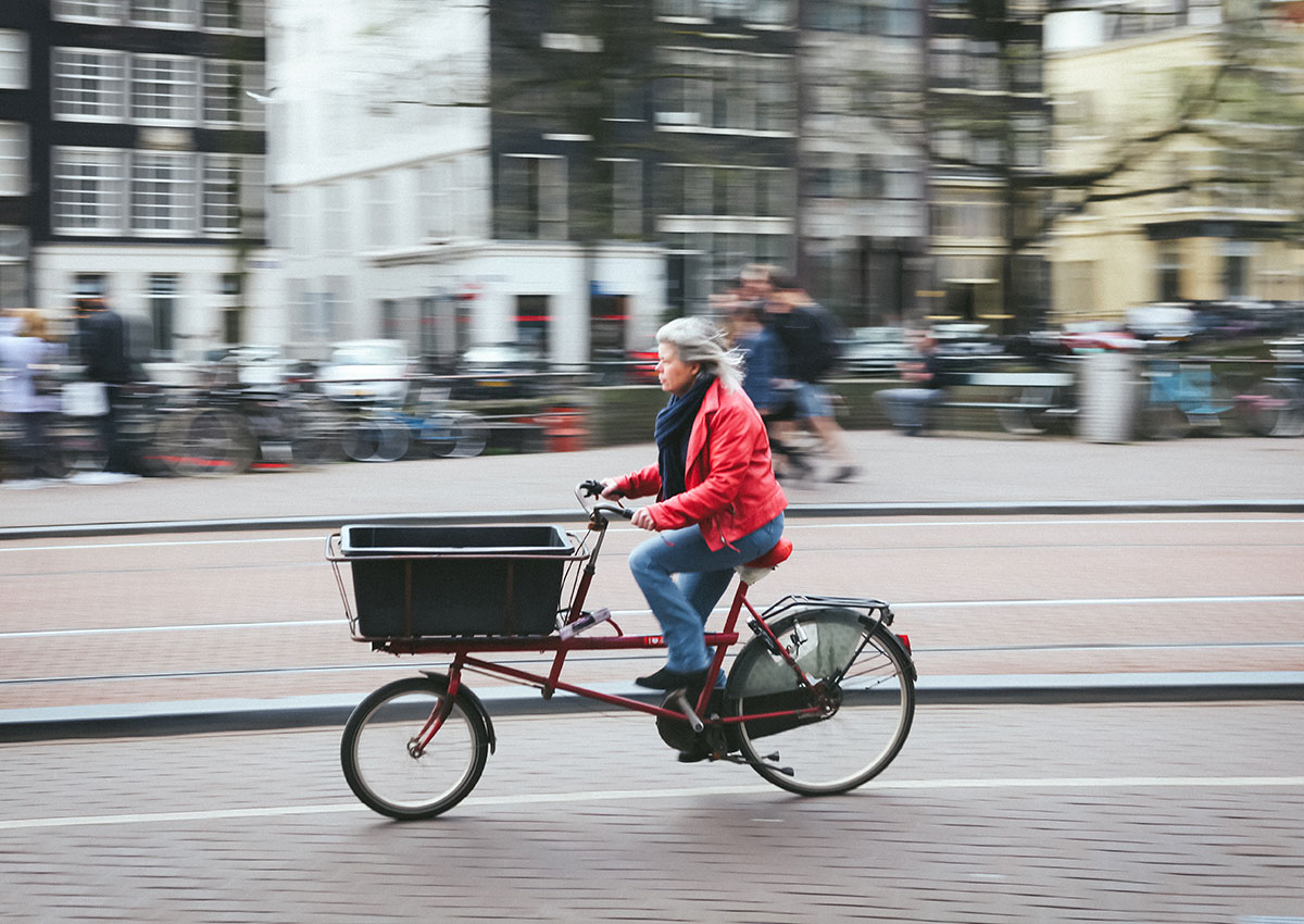 Woman riding a cycle truck