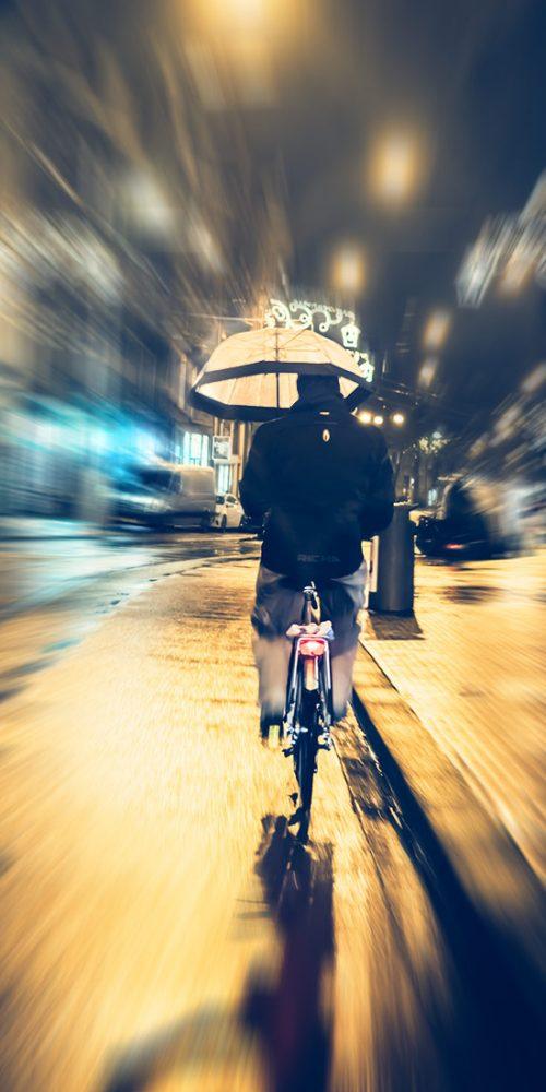 Riding a bike with an umbrella