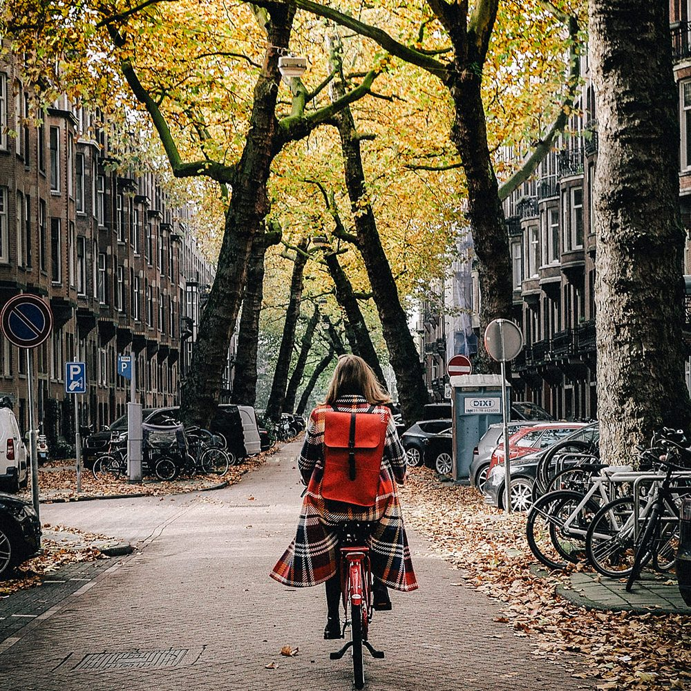 Riding a bicycle in autumn