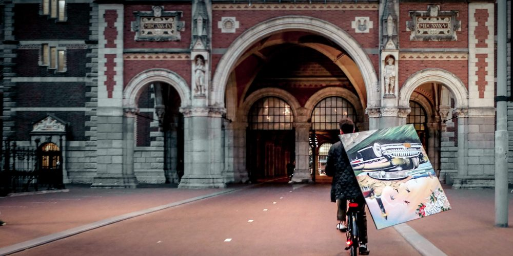 Riding a bike through Rijksmuseam with a painting