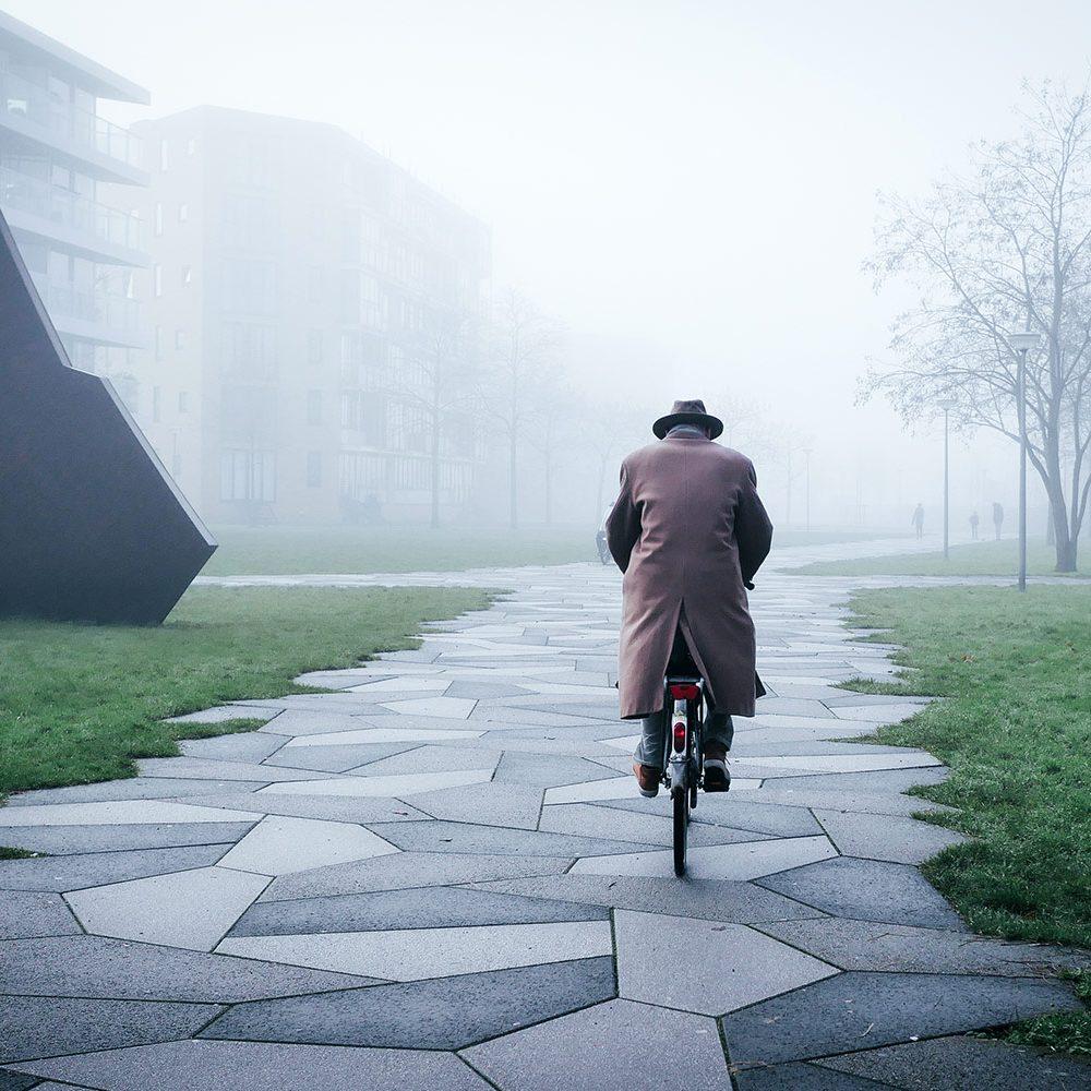 Gentleman riding a bike in the fog