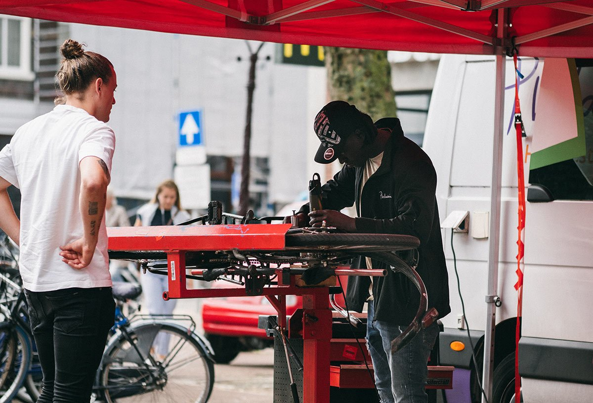Engraving a bicycle in Amsterdam.