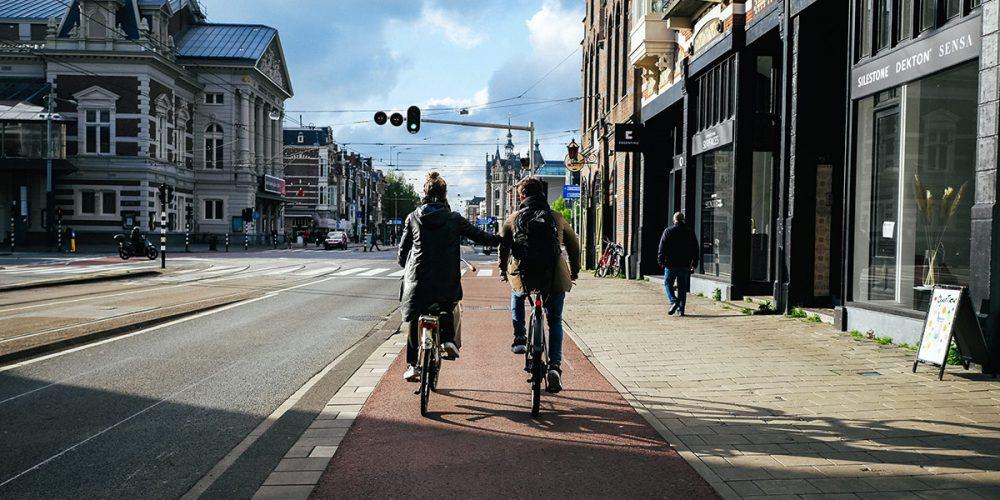 Couple cycling towards Museumplein
