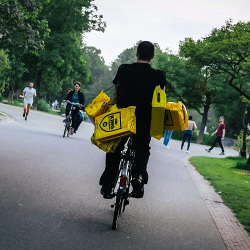Cyclist carrying bags